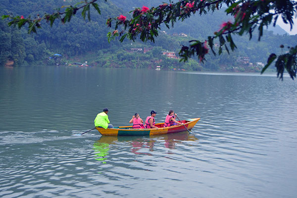 Tourists Enjoyng boating in Phewa Lake during Nepal Highlithts tour