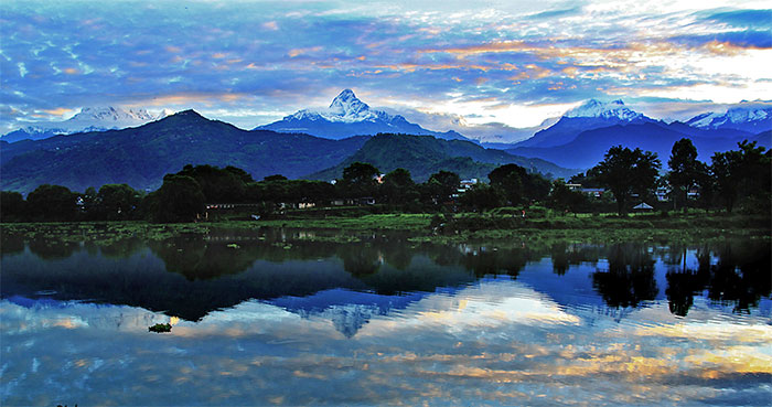 Phewa Lake with reflection of Mt. Fishtail and Annapurna mountain range