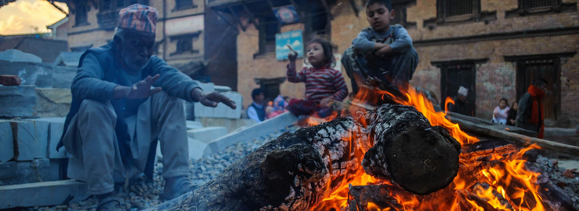 Getting heated from the burning firewood during the festival of Shivaratri